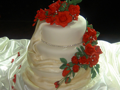 Ivory Drape and Rose Wedding Cake